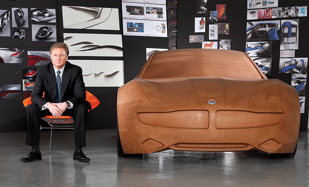 Henrik Fisker with a clay model of his electric luxury car, the Fisker Karma